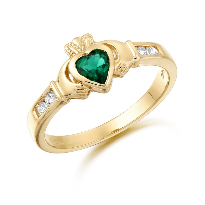 9ct Gold Claddagh Ring studded with Emerald and precision set Cubic Zirconia settings on each side of the shoulder - CL100G
