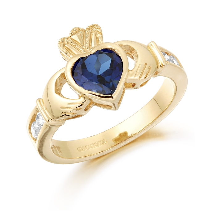 9ct Gold Claddagh Ring studded with Sapphire and precision set Cubic Zirconia settings on each side of the shoulder - CL102S