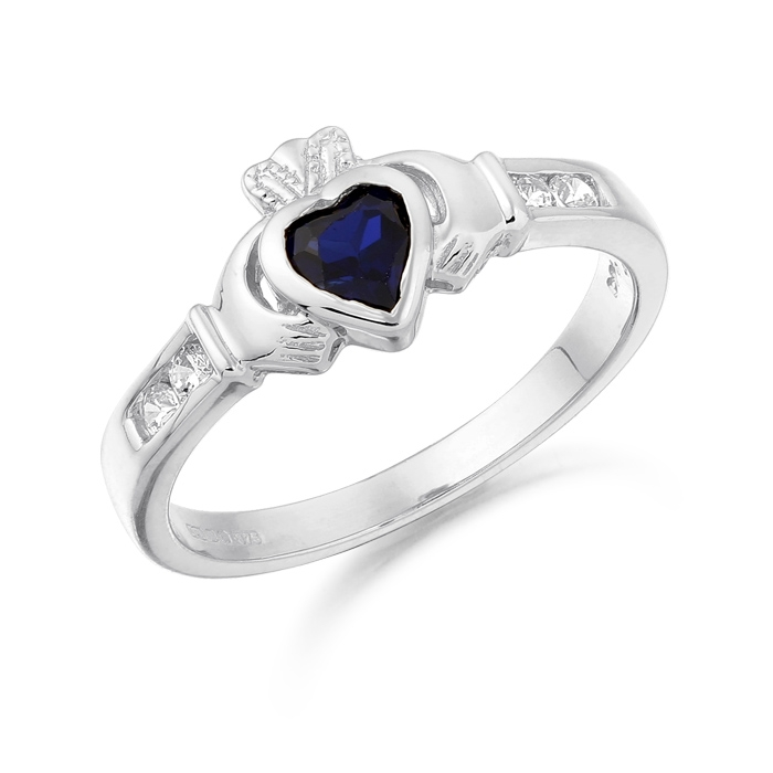 9ct White Gold Claddagh Ring embellished with CZ on shoulders and Heart shape synthetic Sapphire in the Heart - CL100SW